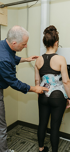 Scoliosis Solutions Victoria BC Chiropractor Dr Brad Gage with Patient